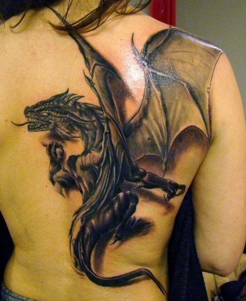 A 3D tattoo of a western fantasy dragon in black tattoo ink