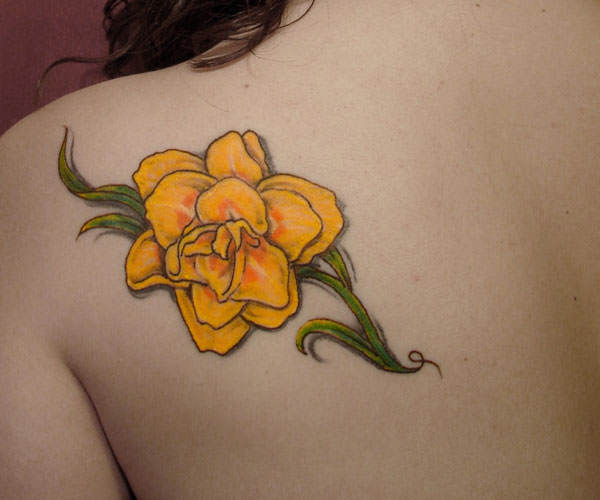 daffodil tattoo is a lovely way to remember a deceased loved one ...