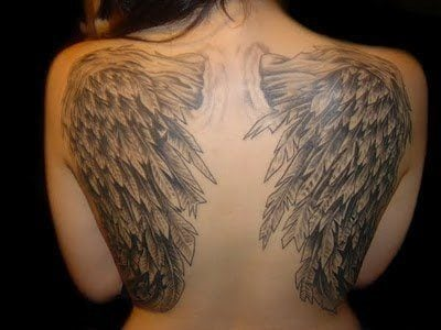A tattoo of angel wings that shows the popular feathered form for angel wings in tattoo art