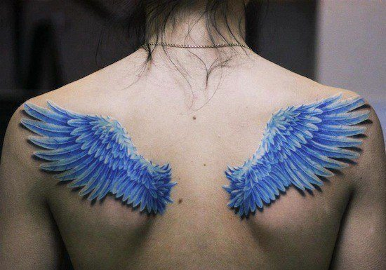 A tattoo of blue angel wings on the back with the feathers of birds wings