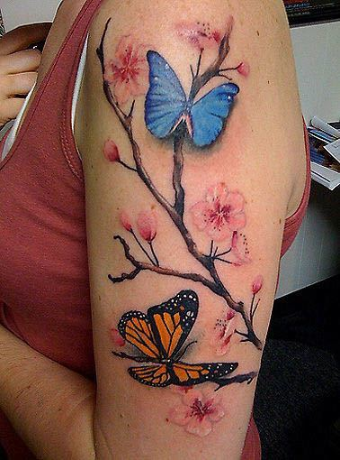 A Tattoo Of A Cherry Blossom Branch And Butterflies Both Of Which