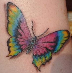 A bright and colorful tie dye butterfly tattoo is a fun way for hippy girls to express their freedom