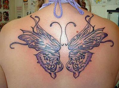 A feminine butterfly tattoo designs with girly colors and curls