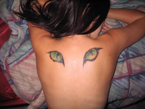 A tattoo of cats eyes on the back can be a symbol of the watchful, protective eyes of the Egyptian cat goddess Bast