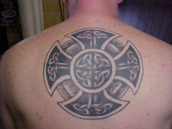 a tattoo of a solar wheel cross made out of celtic knots and circles both symbols for eternity. Black Bedroom Furniture Sets. Home Design Ideas