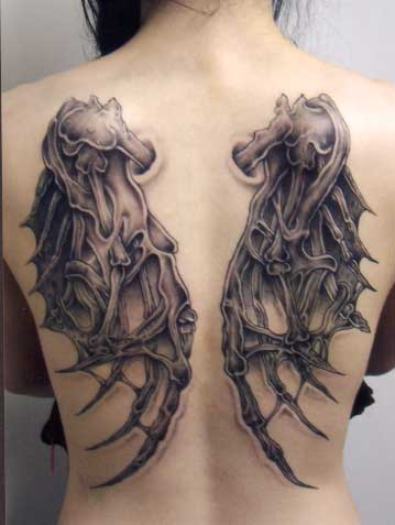 A set of demon or dragon wings make up this gothic tattoo on the back and shoulders