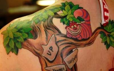 A tattoo of the Cheshire Cat from the Walt Disney film Alice in Wonderland