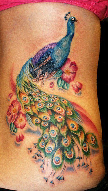 Peacock tattoos are popular with women as a colorful, attractive symbol of pride, beauty and regality