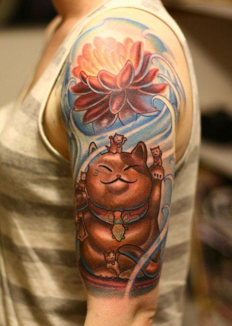 A Japanese maeneko lucky cat tattoo with a lotus flower and kittens is a prayer on skin, wishing for a long and happy life