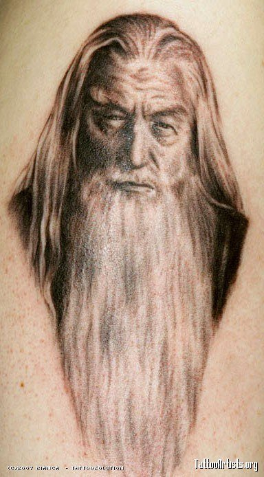 A fan art tattoo of Ian McKellan as Gandalf the Grey in the Lord of the Rings movies, based on the books by JRR Tolkien