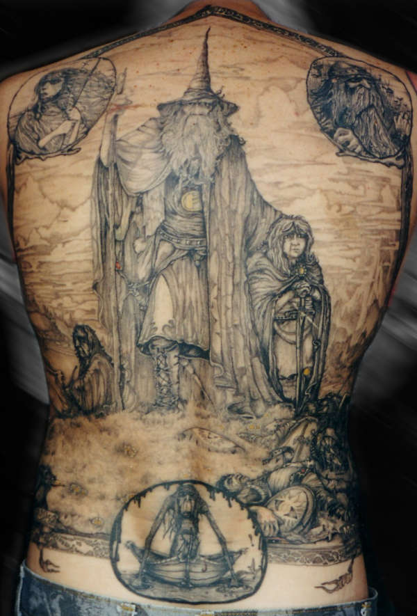 A full back tattoo of an illustrated scene from the lord for Full body tattoo porn