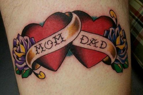 The banners across the two hearts in this tattoo read mom and dad, a celebration of this person's parents