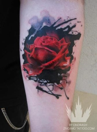 An abstract watercolor tattoo of a red rose flower by tattoo artist Ondrash