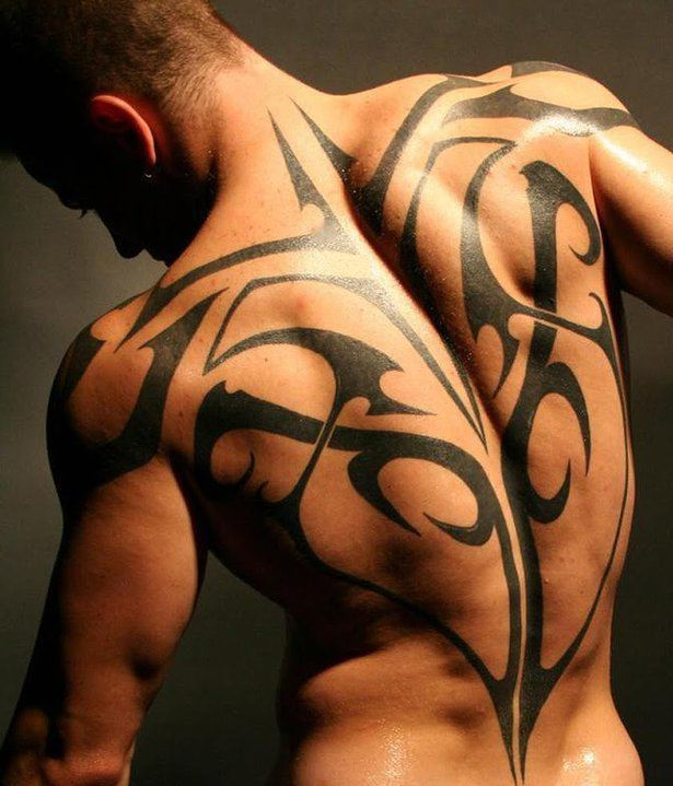 A sexy athletic guy shows off a tribal tattoo design that for Tribal warrior tattoos