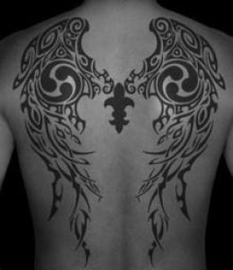 A tattoo of tribal wings can be a symbol of angelic warriors or religious soldiers