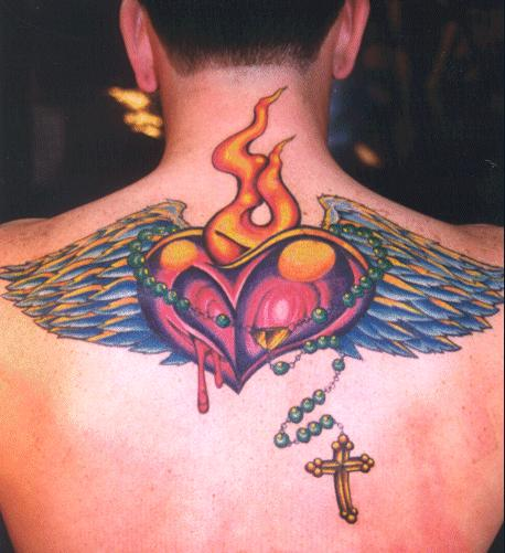 A religious tattoo of a burning, bleeding heart with wings and rosary beads