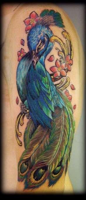 A colorful and elegant peacock tattoo that protrays the watchful nature of the bird