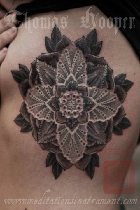 A flower of life mandala tattoo design by Thomas Hooper