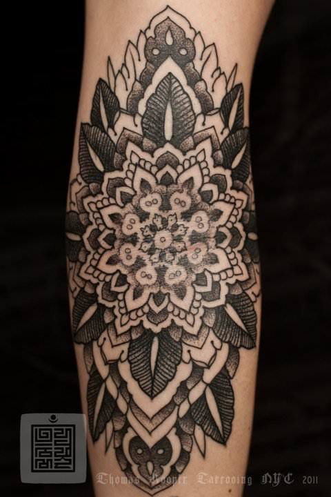 A mandala flower tattoo by Thomas Hooper that celebrates balance, harmony and beauty