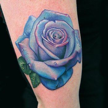 A neat tattoo of a blue rose flower. Blue roses aren't natural - they are white or lavender roses that have been dyed