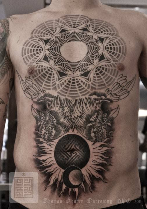 A sacred geometry tattoo by artist and designer Thomas Hooper with birds, sun and moon
