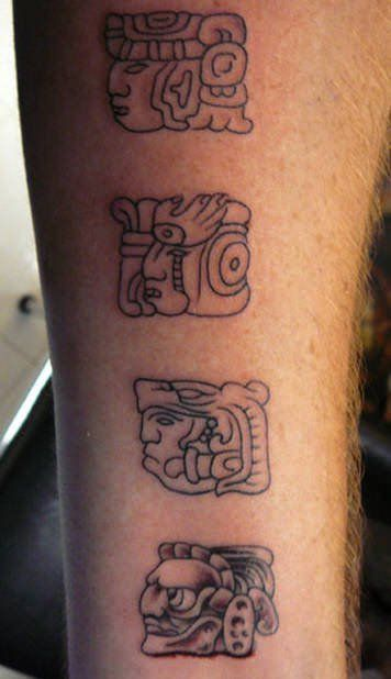 A tattoo of Mayan symbols representing gods and deities