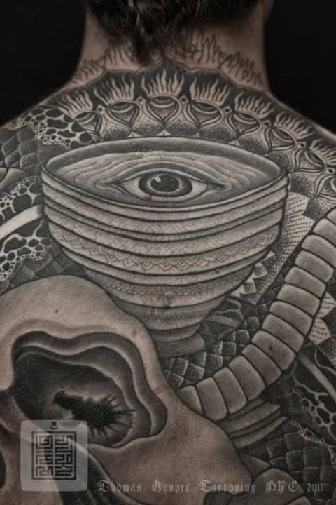 An eye is at the focal point of this Thomas Hooper geometric tattoo. The circles draw the viewer's attention to the eye tattoo.