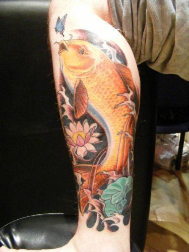 This tattoo combines the symbols of a golden koi carp with a lotus flower, butterfly, lily pad and water.