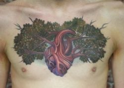 Tree of life tattoo with a tree growing out of a human heart, symbolizing the cycle of life.