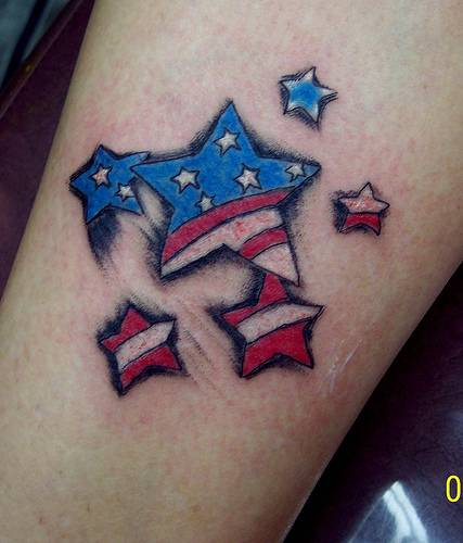 A Patriotic Tattoo Of The American Flag That Has Stars