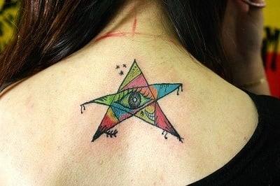 This avant garde star tattoo design boasts an eye at its center