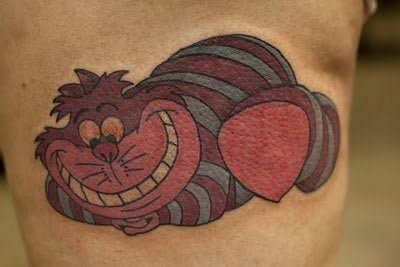 A colorful tattoo of the Cheshire Cat from the Walt Disney movie Alice in Wonderland