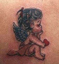 A cute love tattoo of a cupid holding a heart, perfect idea for a valentines day tattoo