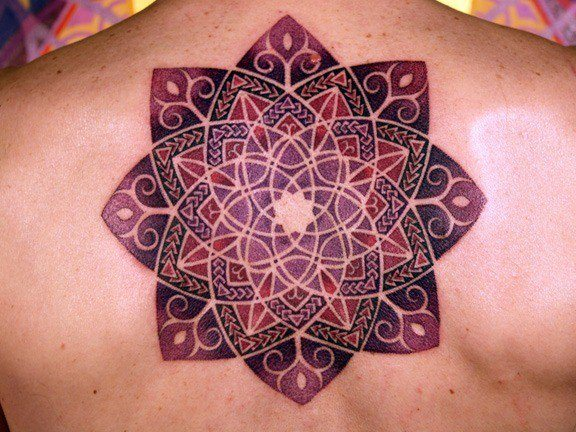 the pattern of curved lines appears almost animated giving this flower mandala tattoo a lively. Black Bedroom Furniture Sets. Home Design Ideas