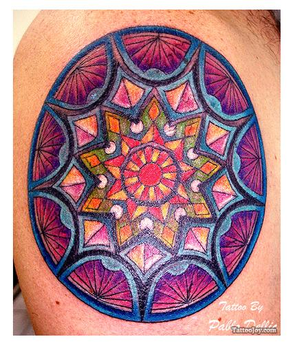 Many mandala tattoo designs resemble the colorful patterns found in the rose windows of Christian churches