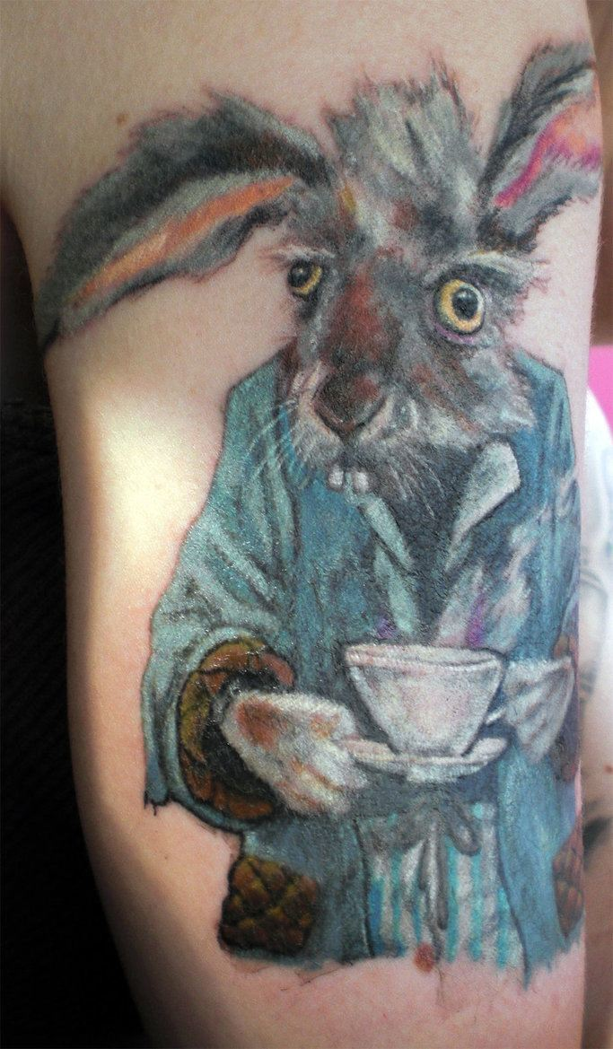 A funny tattoo design of the March Hare with a cuppa tea from Alice in Wonderland
