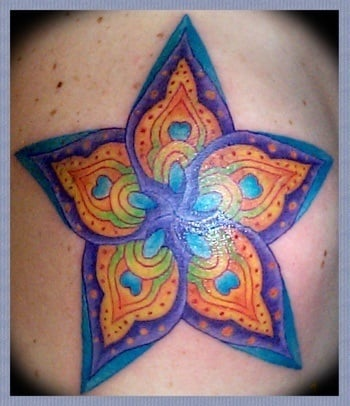 A spiritual, new age tattoo design of a star flower