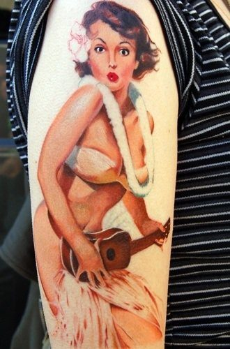 A suggested nude pin up girl tattoo of a hula girl playing a guitar with no pants on