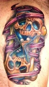 skull hourglass ribbon tattoo life death time mortality symbol meaning of