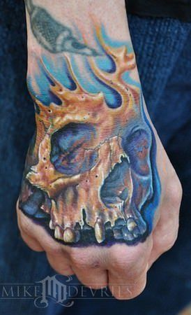 skull tattoo on hand death's head no lower jaw symbol sign death loose morals