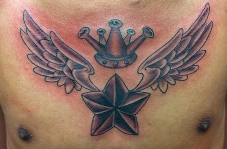 This flying star and crown tattoo is a symbol of personal pride and strength