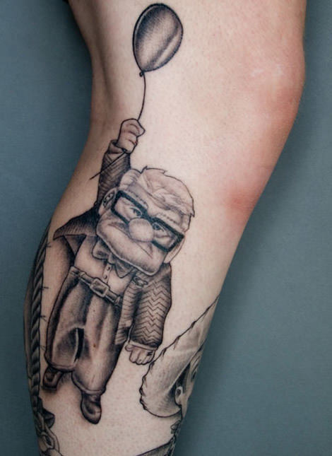 A black and white tattoo of the old man, Carl Fredrickson, from the Pixar movie Up