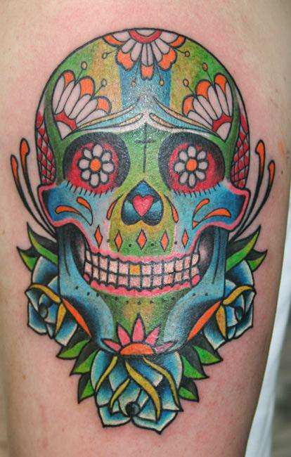 A colorful day of the dead sugar skull tattoo design also for Sugar skulls tattoos meaning