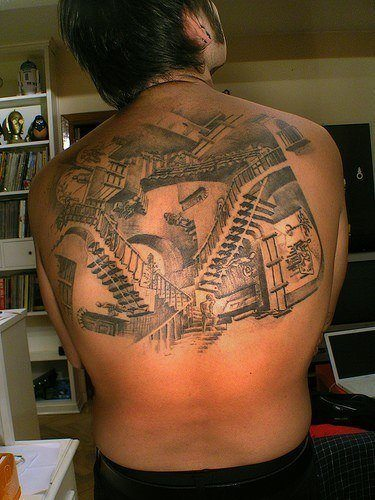A large back tattoo of the stairs of relativity by graphic designer and artist MC Escher