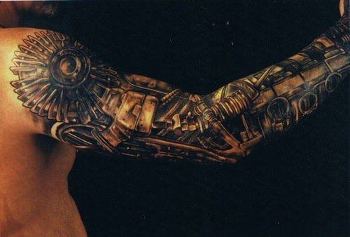 A steampunk tattoo design that creates the illusion that the guys arm is made of mechanical elements