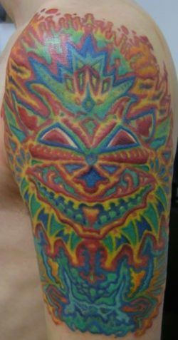 A Trippy Tattoo Of A Psychedelic Drawing Of A Cat By