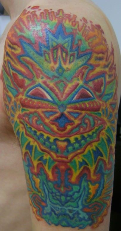 A trippy tattoo of a psychedelic drawing of a cat by famous schizophrenic artist Louis Wain