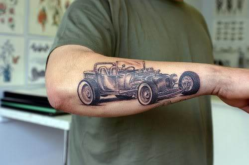 An antique car tattoo design that shows the typical early 20th century style of cars