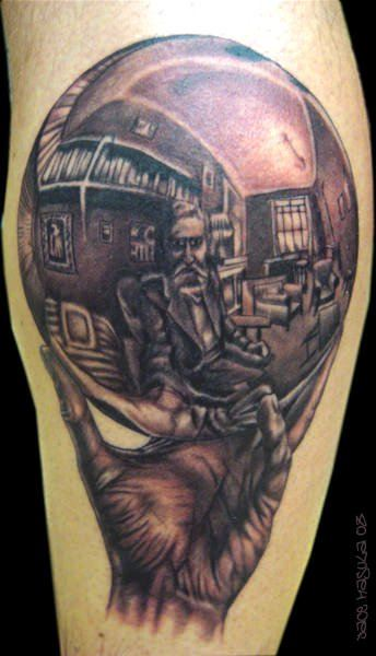 An optical illusion tattoo of MC Escher drawing his own reflection in a silver ball