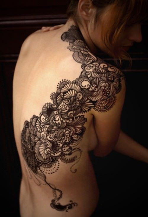 Even though this isn't lace, this delicate and decorative tattoo design is inspired by lace designs